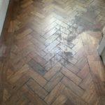 sanding and waxing herringbone parquet floor
