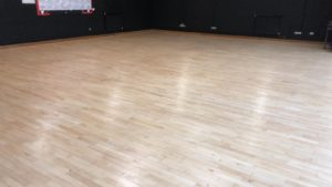 Rudheath Senior Academy sports floor restored using Junckers HP sport lacquer.
