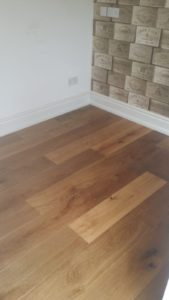 V4 Oak Smoked VIT108 transforms this home by changing a traditional herringbone into a modern and stylish straight plank hardwood.
