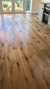 A fabulous floor brought back to life along with a matching worktop - a solid Oak hardwood finished with WOCA hardwax extreme.