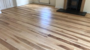 Ash flooring restored to its former beauty